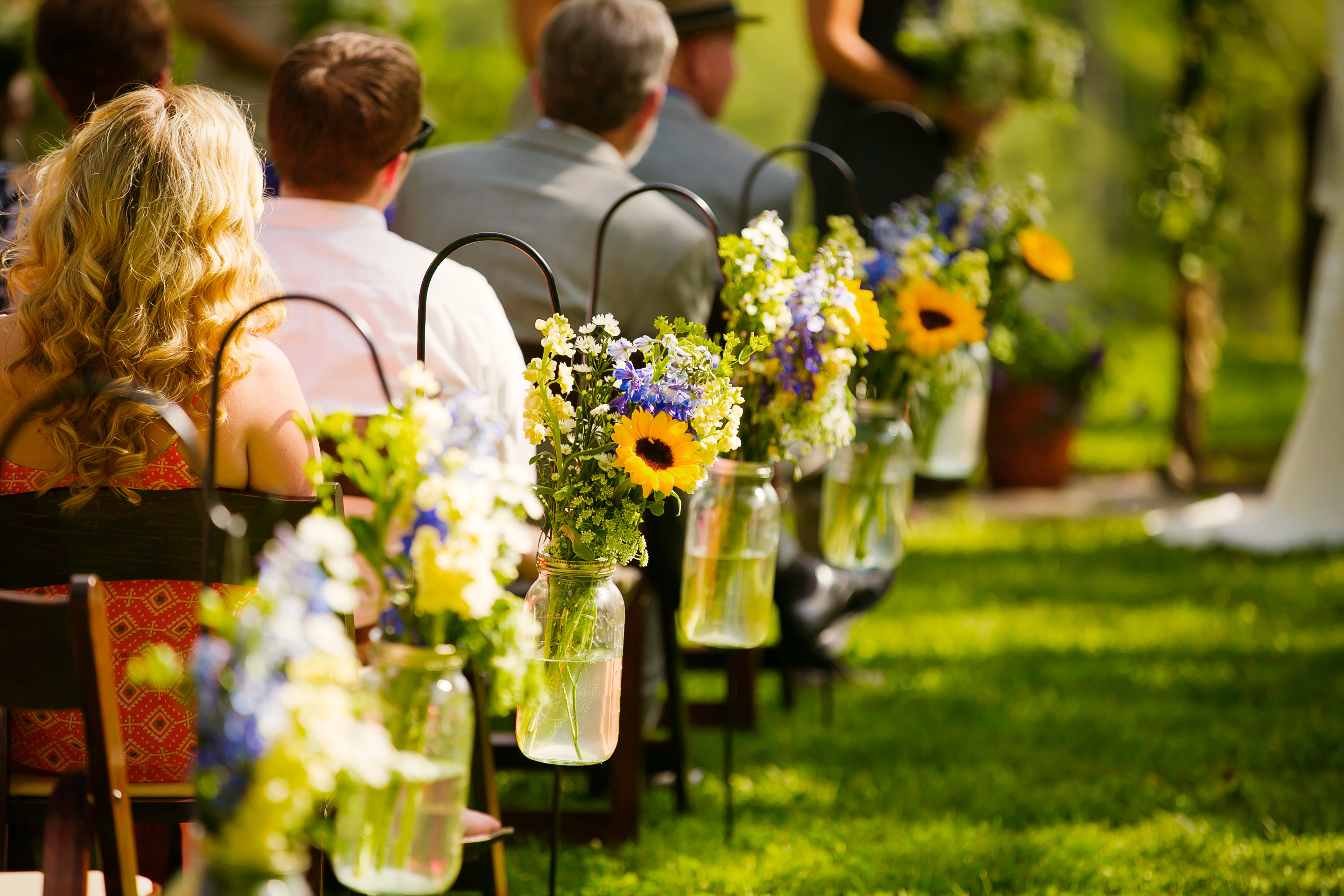ceremony flowers on bench sides