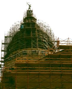 The Kansas State Capitol Building surrounded by construction scaffolding.