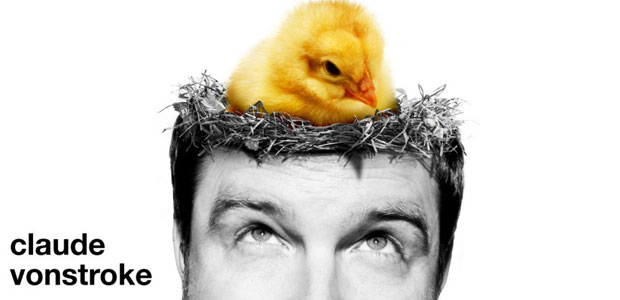 Claude von stroke with a little chicken on the head for a interview