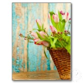 Spring may flower basked with pink tulips postcard