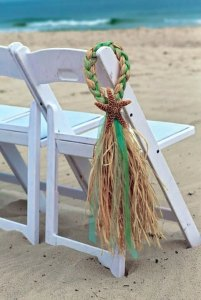 starfish and raffia beach wedding isle decorations