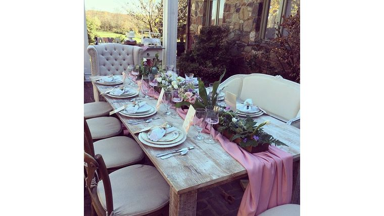 White washed farm table to rent for a boho themed wedding