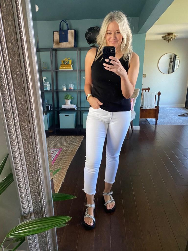 black tank white jeans