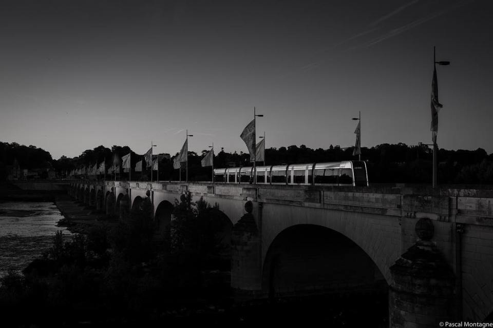 Sunset on Loire valley in Tours. Reflections on the tramway #sunset #loire #loirevalley #france #tourism #blackandwhitephotography #blackandwhite #shadows #reflection #light #river #bridge #picoftheday #dailypic #pictureoftheday #instagood #instalike