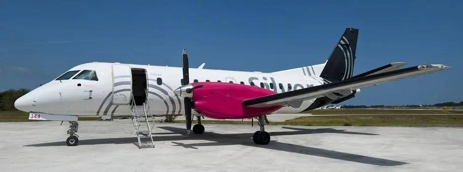 silver-plane-on-ground