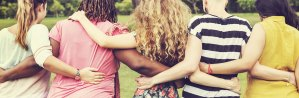 Women facing away hugging with arms around eachother | | Frequently Asked Questions about Women's Therapy & Pregnancy Counseling | Passages Wellness & Counseling for Women | East Setauket, NY 11733