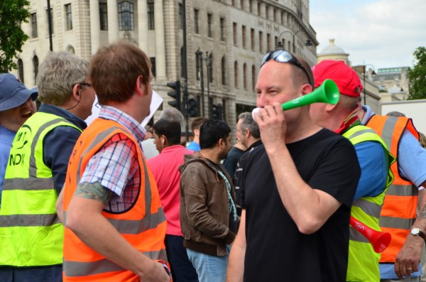 London Cab strike. 11 June 2014.  Cab horns and vuvuzelas or the  lepatata Mambu (its Tswana name), a plastic horn add to the impact!