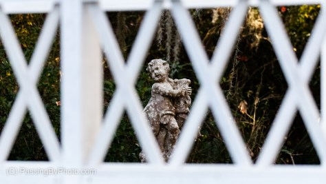 Long White Bridge, Cherub Statue Through Lattice