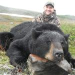 happy-hunter-with-black-bear-trophy-in-newfoundland