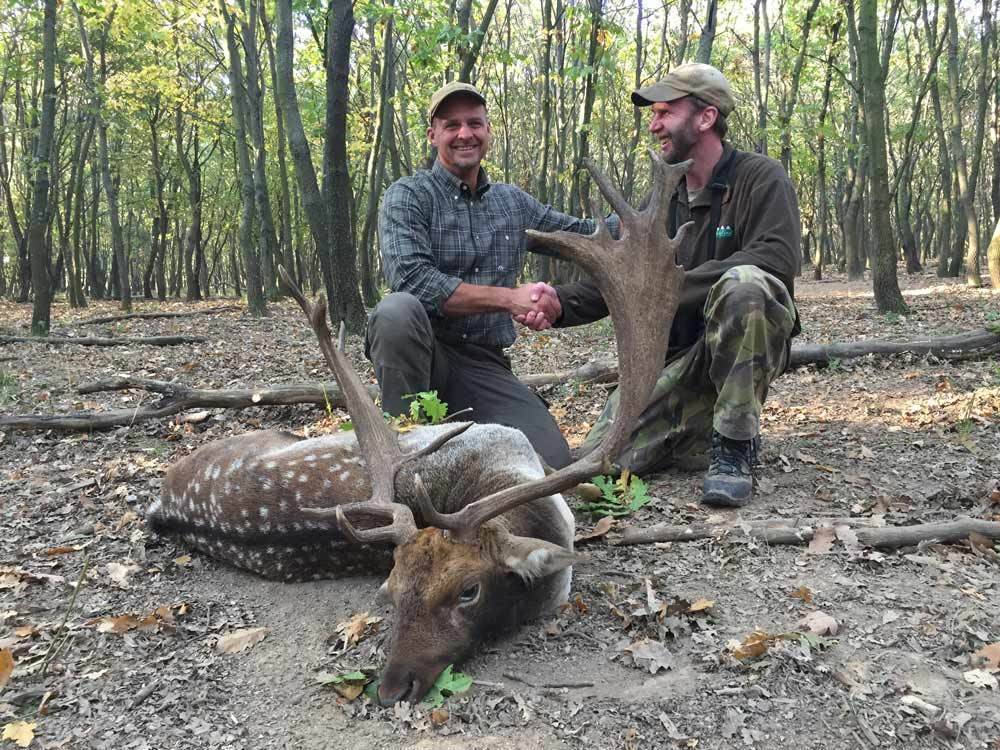 hunter-with-guide-and-fallow-buck-trophy-in-Hungary