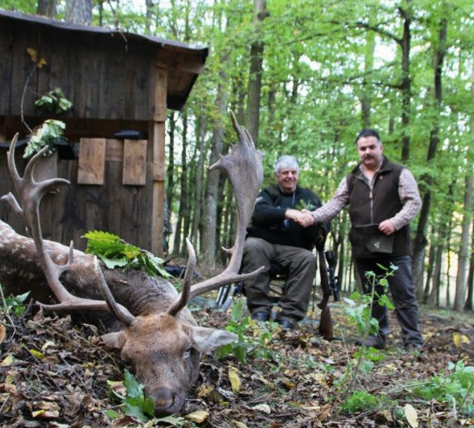 wheelchair hunter with trophy in europe