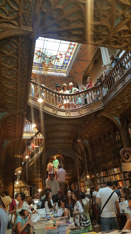 Inside the Livraria Lello, the stairs are red on top