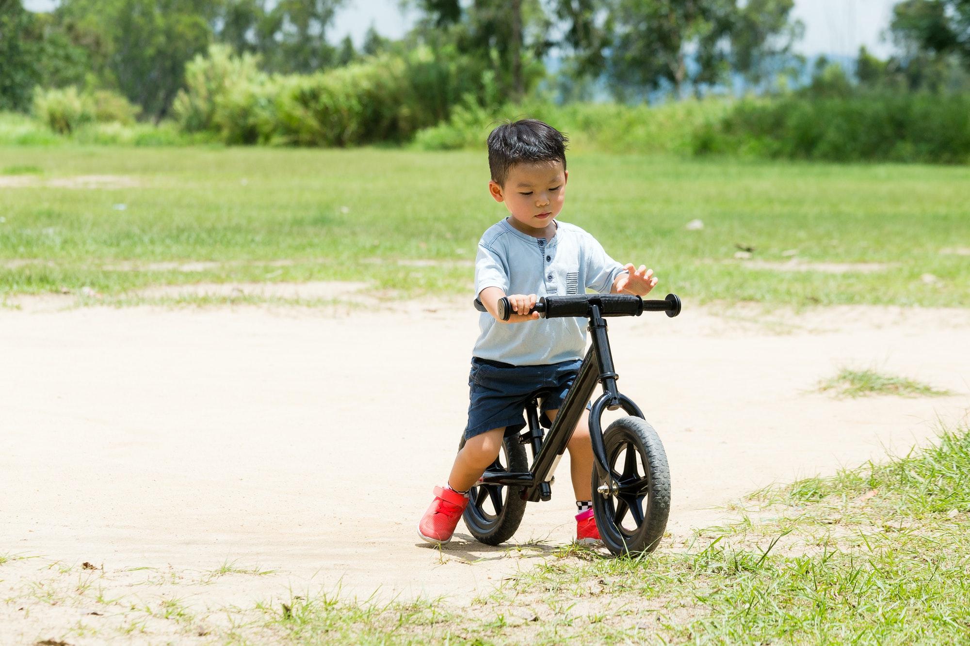 Small kid riding a bike