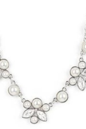 Infused with solitaire pearls, dainty clusters of bubbly white pearls and glassy white marquise style rhinestones delicately gather into clustered frames below the collar for an elegantly timeless finish. Features an adjustable clasp closure.
