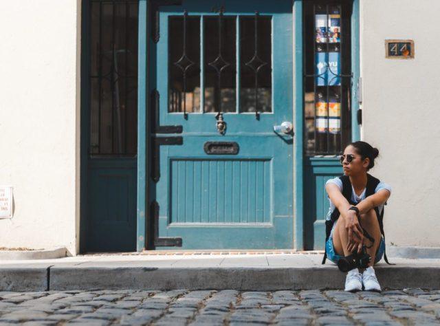 woman traveler sitting on street