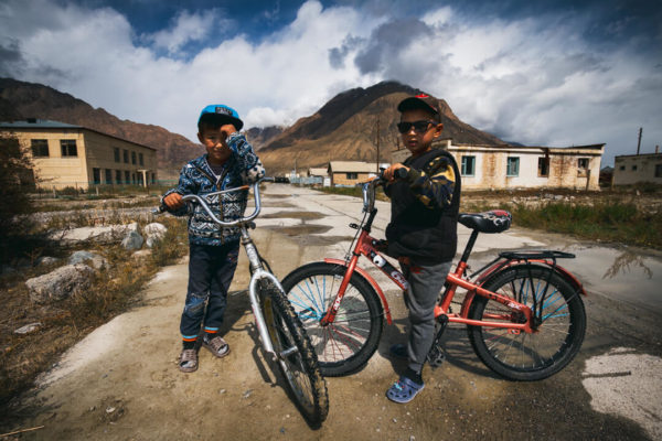 Boys on bicycles in a Soviet ghost town in Central Asia.