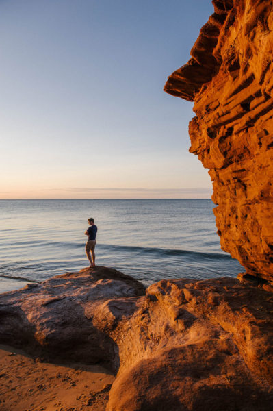 a sunset at the red cliffs of thunder cove on prince edward island.