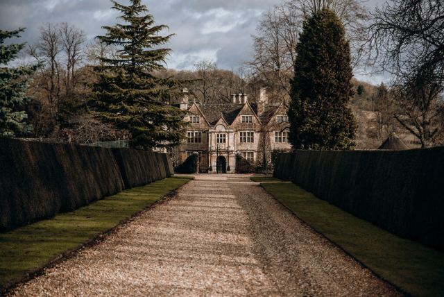 a path leading to a manor house in a british village