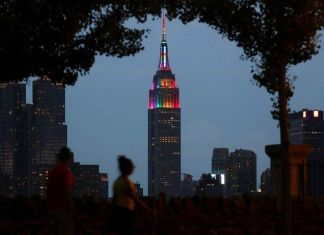 nyc empire state building lit up in lgbtq events colors