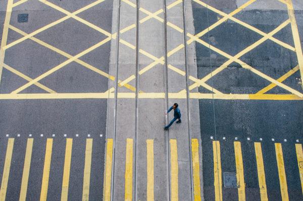 lone man in crosswalk