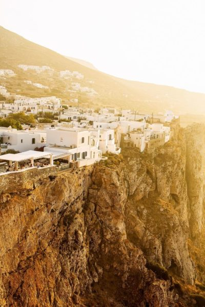 white buildings on cliff at sunset