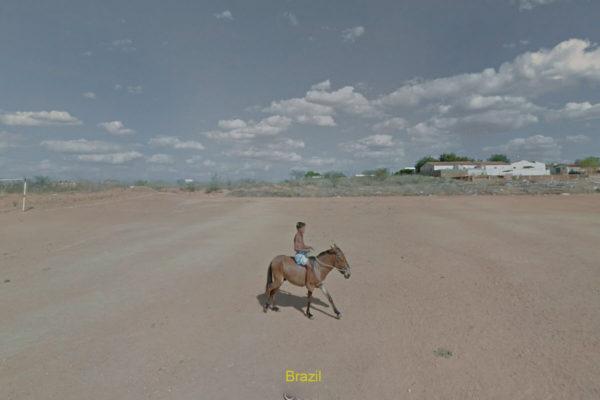 boy riding horse in desert