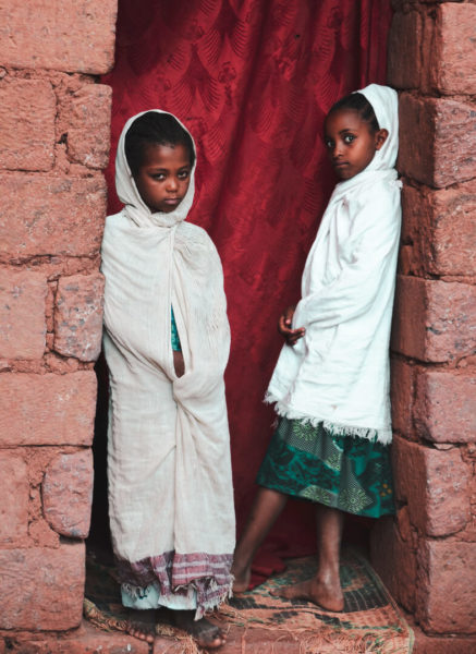 ethiopian girls standing in church doorway
