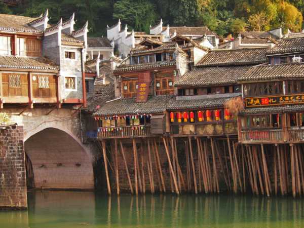 chinese buildings on stilts in river