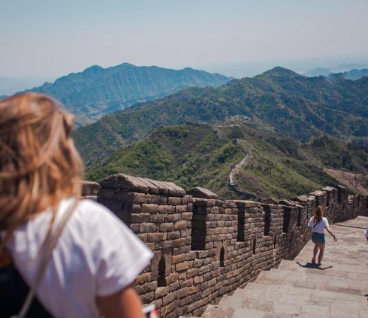 woman walking on great wall of china