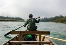 man in rowboat