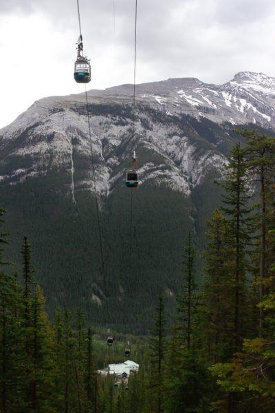 aerial tramway traveling toward mountain