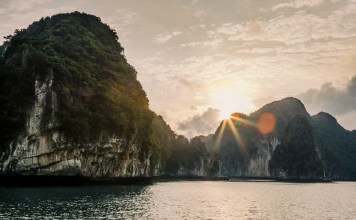 sun setting over rock