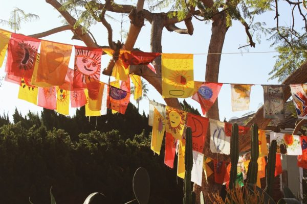 homemade prayer flags hanging from laundry line
