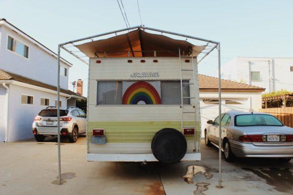camper van with rainbow in back window