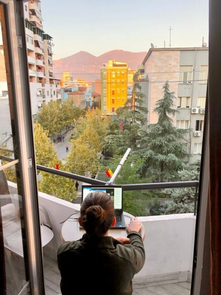 remote worker at a laptop on a balcony