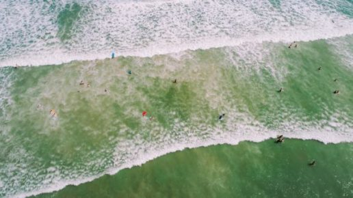 aerial view surfers in water
