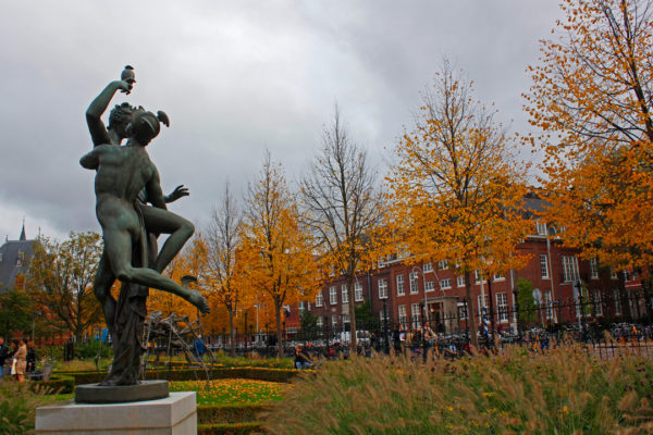 statue autumnal trees