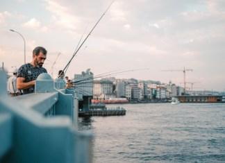 fishermen on istanbul's galata bridge