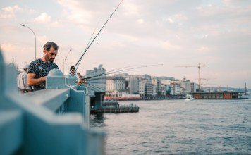 fishermen on istanbul's galata bridge