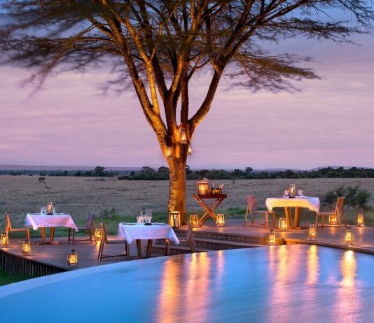 Bateleur Camp in Kenya at sunset with pool and dinner tables
