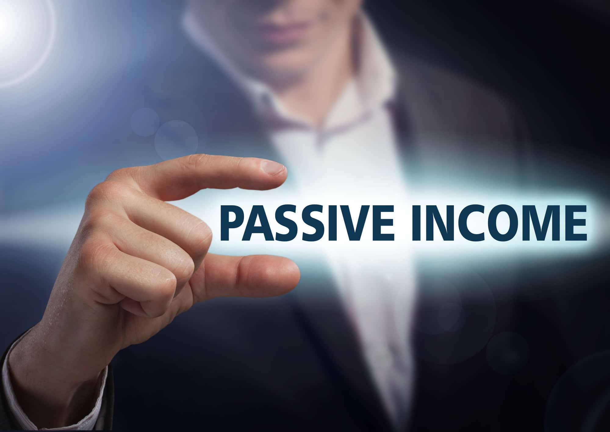 Businessman presses button passive income on virtual screens. Bu