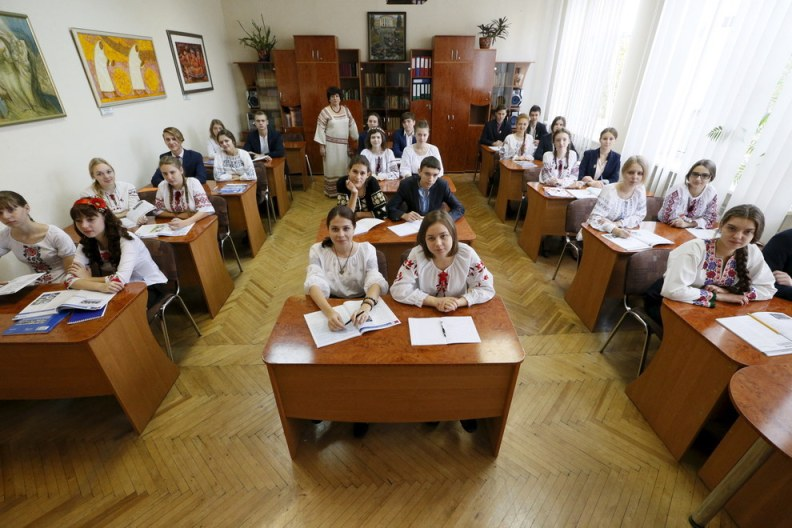 Art teacher Hanna Snitko poses for a picture with final year students of the Ukrainian Humanities Lyceum in their classroom in Kiev, Ukraine. Gleb Garanich - Reuters