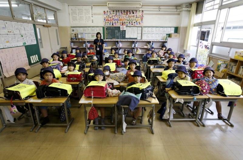 First-grade students with their teacher Teruko Takakusaki during their homeroom period at Takinogawa Elementary School in Tokyo, Japan. Reuters