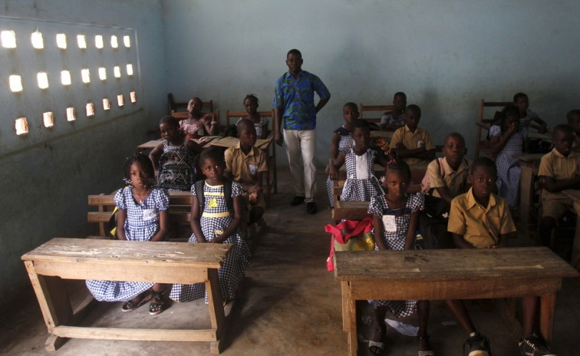 Teacher Kahon Rochel with students at the the EPV Sinai primary school in Abidjan, Ivory Coast. Luc Gnago - Reuters