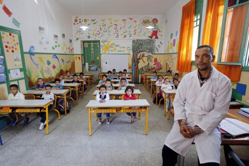 Teacher Moulay Ismael Lamrani with his class in the Oudaya primary school in Rabat, Morocco. Youssef Boudlal  Reuters