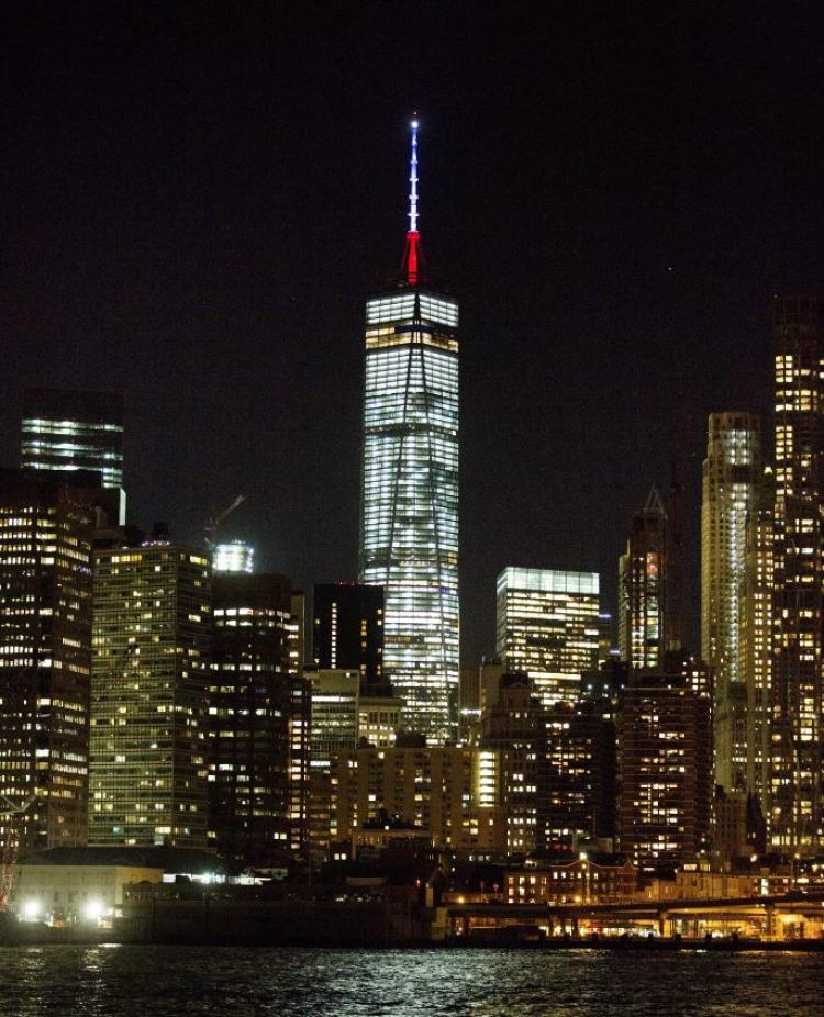 United States - Mast of the One World Trade Centre in New York beaming in the colours of France