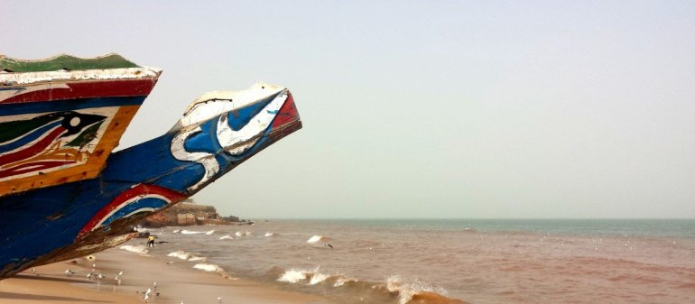 Painted Fishing Boat on a Beach in The Gambia, West Africa