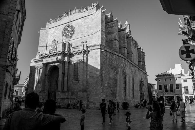 Girl taking photo of church in Ciutadella Menorca in Spain