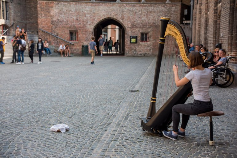 Girl Playing Harp - A Travel Guide to Bruges, Belgium