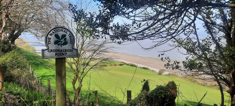 National Trust sign at Greenaleigh Point overlooking a seaview on the South West Coast Path from Minehead to Porlock Weir